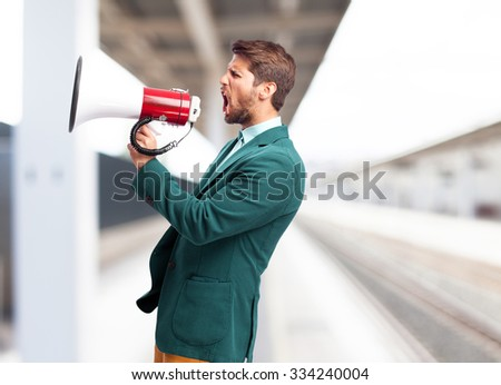 shouting businessman with megaphone - stock photo