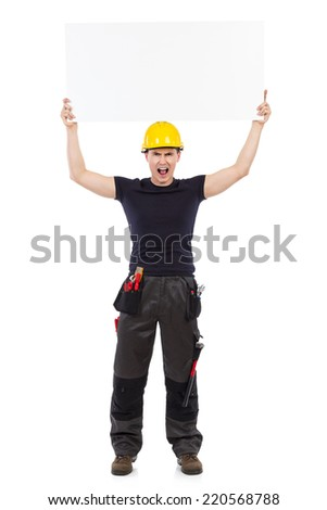 Shouting construction worker standing and holding banner over his head. Full length studio shot isolated on white. - stock photo