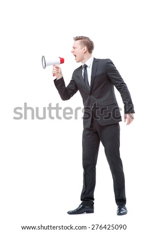Shouting louder! Full length of young businessman using megaphone. Isolated on white.