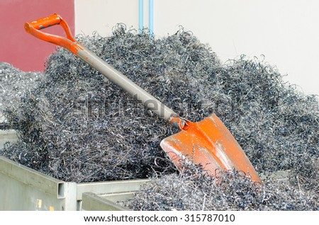 Shovel and Twisted spiral steel shavings. Drilling milling and lathe industry.