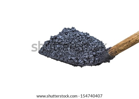 shovel full of asphalt at Road Construction