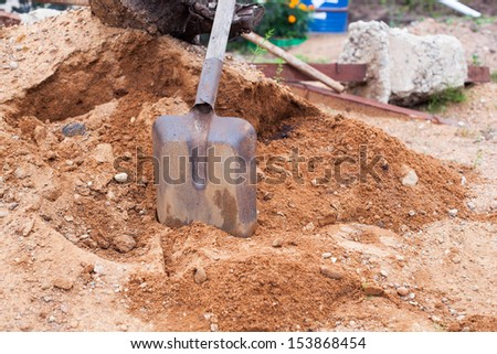 Shovel in sand,  mixing cement