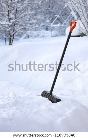 shovel in snow on nature - stock photo