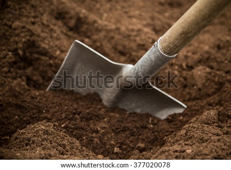 Shovel in the ground, close-up. - stock photo