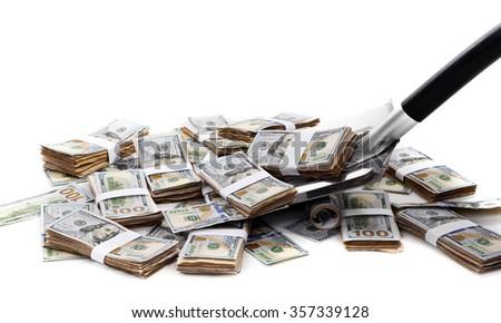 Shovel lifts dollar bills on white background - stock photo