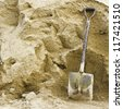 Shovel sand for construction.,A shovel in a sand - stock photo