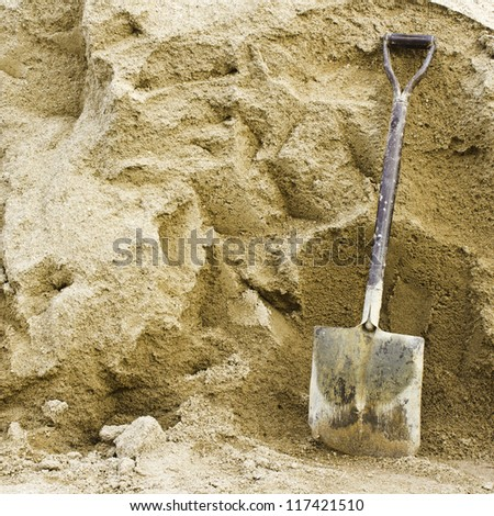 Shovel sand for construction.,A shovel in a sand - stock photo