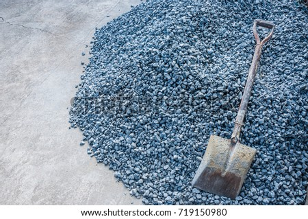 Shovel with Crushed rock in construction work.