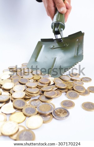 shovel with money - stock photo