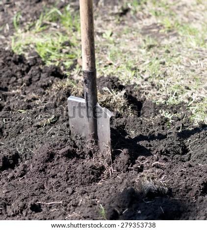shovel with soil - stock photo