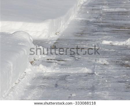 Shoveled Snow Sidewalk - stock photo