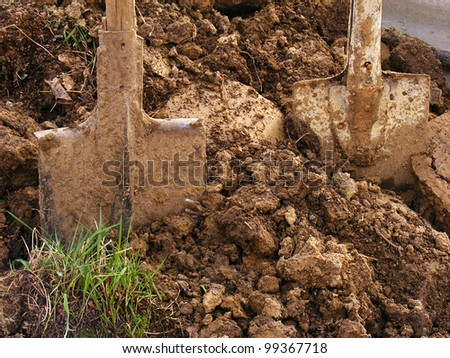 Shovels in the ground - stock photo