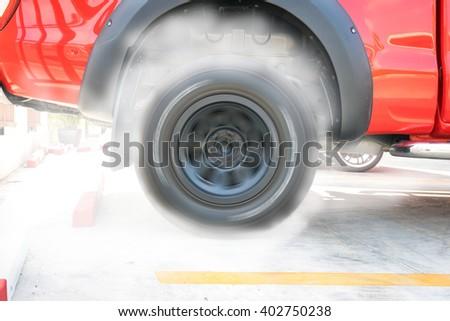 Show burning tires racing in racetracks. - stock photo