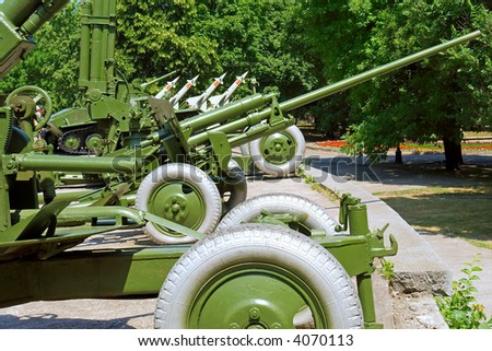 Show of Soviet-times Russian weapons in city park. Shot in June, near Dnieper river (Dniepropetrovsk, Ukraine). - stock photo