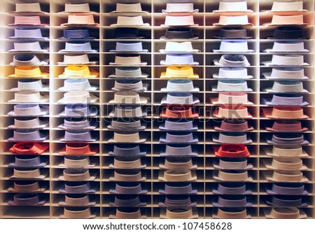 Showcase with many colorful shirts on shelfs - stock photo