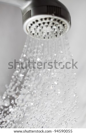 Shower and flying water drops. - stock photo