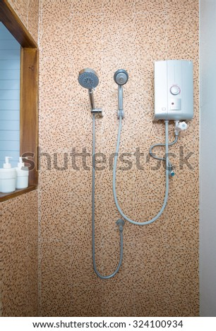 shower and water heater in bathroom. - stock photo