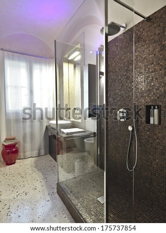 shower cubicle with mosaic tile in the modern bathroom - stock photo