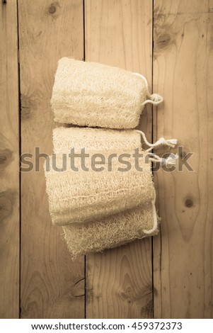 shower equipment made from fiber of zucchini on wood pallet background