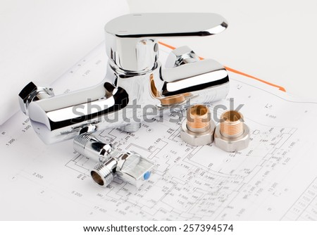 shower faucet, plumbing and tools lying on drafting for repair  - stock photo