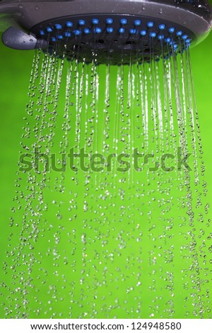 Shower head and flowing water. - stock photo