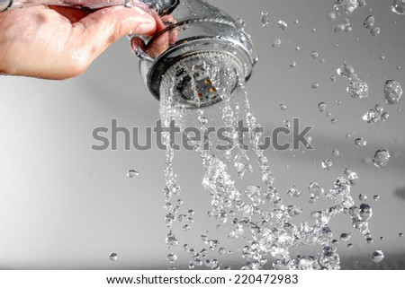 Shower head in hand