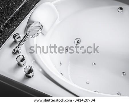 shower head of jacuzzi bath tub - stock photo