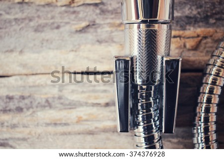 Shower head on wood background - stock photo