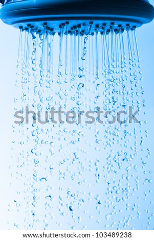 Shower Head with Droplet Water, Blue background - stock photo