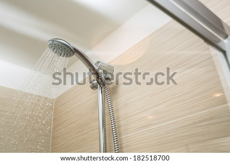 Shower head with dropping water - stock photo