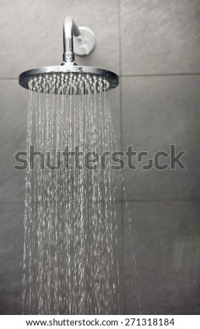 Shower head with water stream. - stock photo
