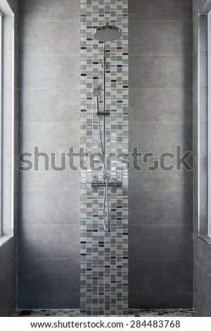 shower on tile wall