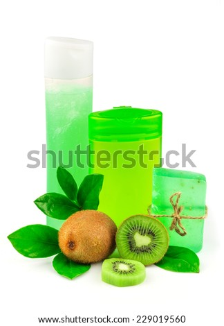 Shower products with fruit and green leaves isolated on white background - stock photo