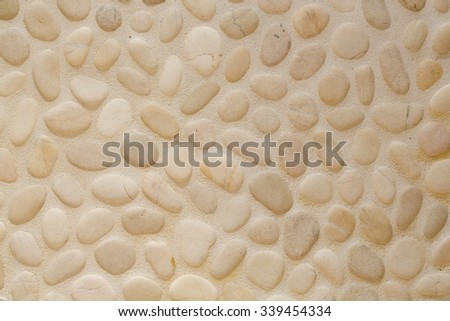 Shower wall with decorative pebble cladding.Close up - stock photo