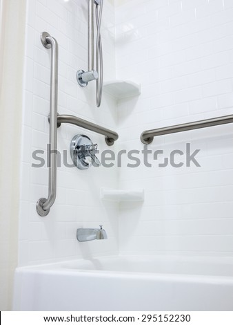 Shower with handicapped disabled access grab bars and removable shower head - stock photo