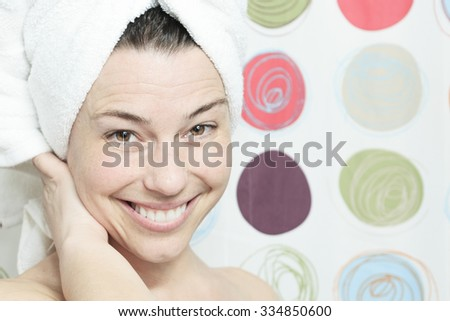 Shower woman. Happy smiling woman washing shoulder showering in bathroom. - stock photo