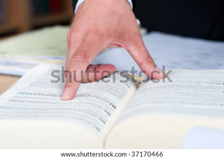 showing a book - stock photo
