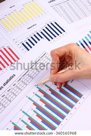 Showing financial chart, business concept, analysis of sales plan, business report, business work station with paperwork - stock photo