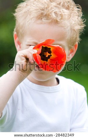 Showing his fresh flower. - stock photo