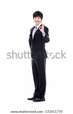 Showing okay sign young Asian business man isolated on white background.  - stock photo