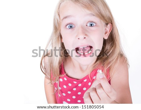 Showing or holding first missing or loose tooth  - stock photo