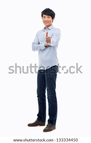 Showing thumb Asian young  man  isolated on white background.