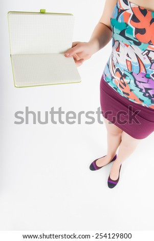 Showing woman holding blank open book diary with copy space for your text or design. High angle view on white background. - stock photo