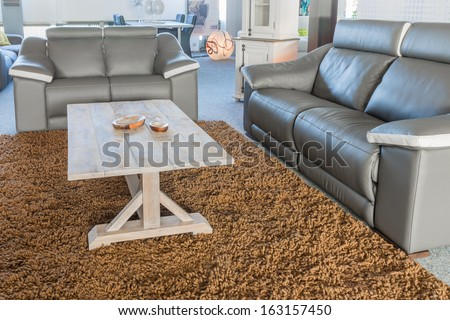 Showroom furniture shop with a modern sitting area - stock photo