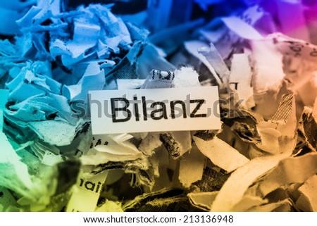 shredded paper for keyword balance, symbol photo for data destruction, accounting, and economic analysis - stock photo