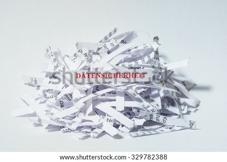 Shredded Paper, German: Data Security - stock photo