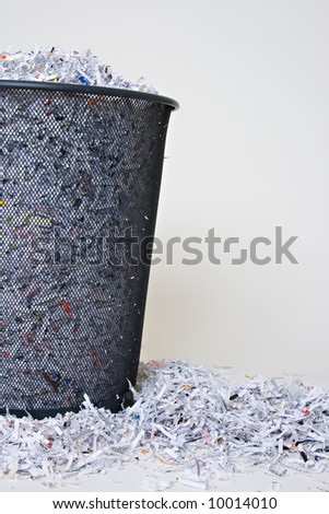 Shredded Paper in and around the basket with blank space on the right side - stock photo