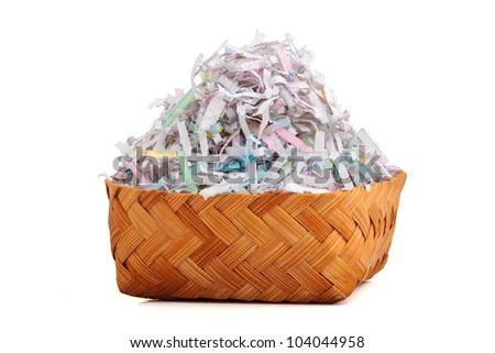 Shredded paper in bamboo basket. Concept of environmental recycle.