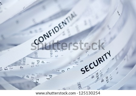 "Shredded paper series - confidential  and security. Selective focus on word ""security"" - stock photo"