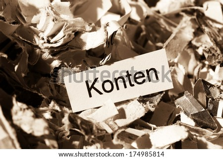 shredded paper tagged with accounts, symbol photo for finance, secret accounts and double entry bookkeeping - stock photo
